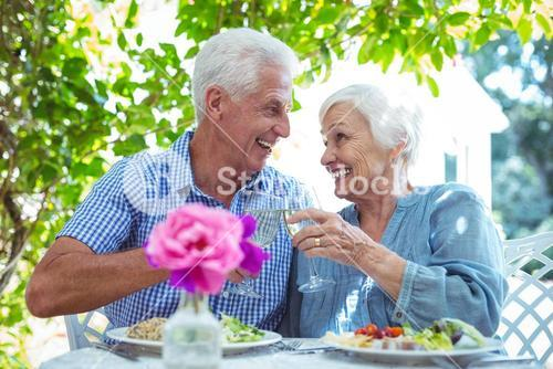Senior couple toasting white wine