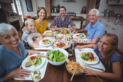 Portrait of happy family celebrating thanksgiving