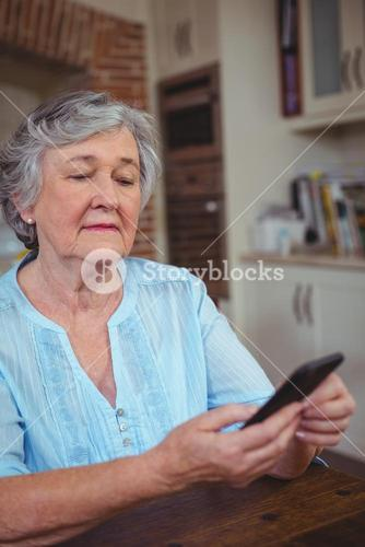 Senior woman text messaging on phone
