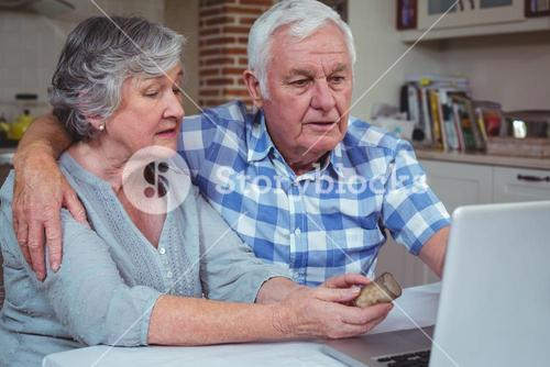 Senior woman with pills interacting with husband