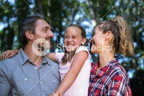 Laughing daughter with parents
