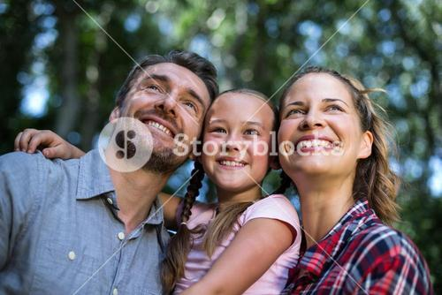 Happy parents with daughter in back yard