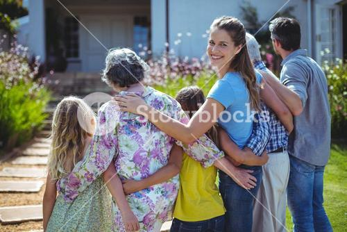 Cheerful woman with family in back yard