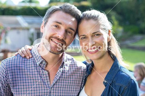 Portrait of young couple in back yard