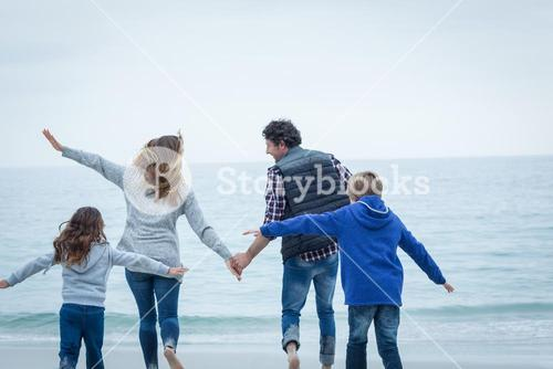 Children enjoying with parents at shore
