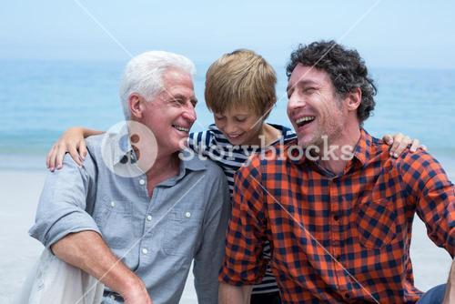 Multi-generation family relaxing at beach