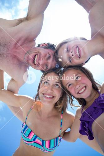 Directly below shot of cheerful family huddling