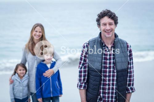 Father with mother and children at beach