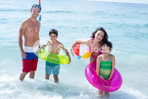 Happy mother and father with children at beach