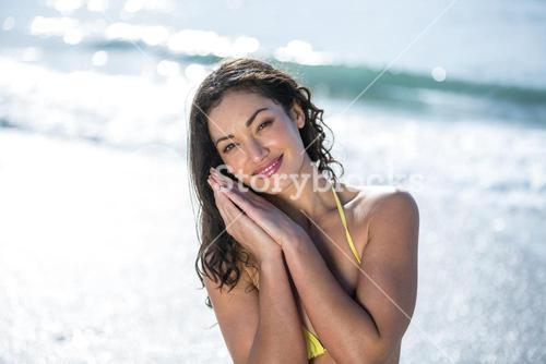 Happy beautiful woman at sea shore on sunny day
