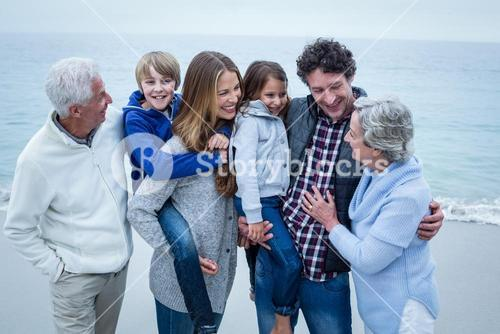 Multi-generation family enjoying at shore