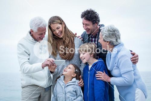 Happy family looking in phone