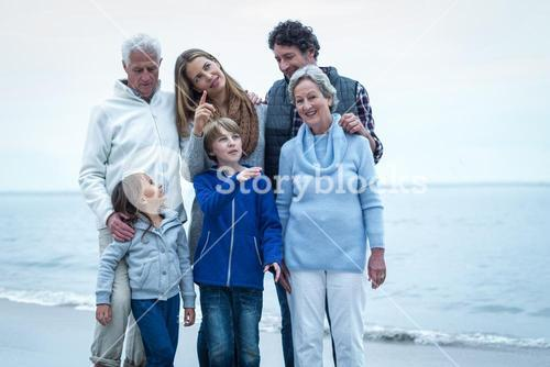 Happy family standing at beach