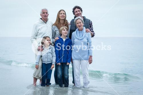 Family standing at beach