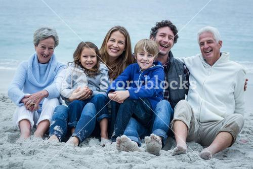 Cheerful family sitting at beach