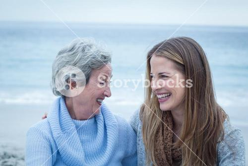 Daughter with mother at beach