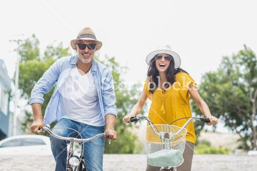 Portrait of happy couple cycling