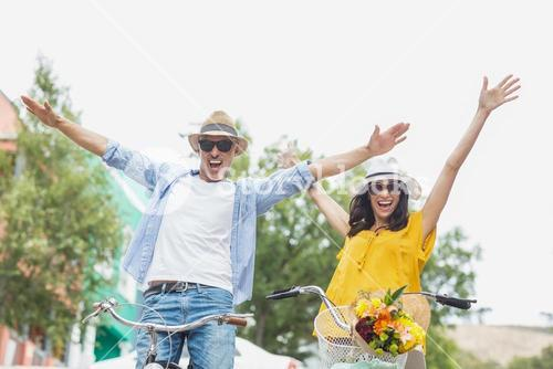 Portrait of excited couple with bicycles
