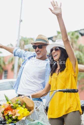 Excited couple with arms raised
