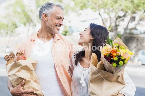 Happy couple with grocery bags