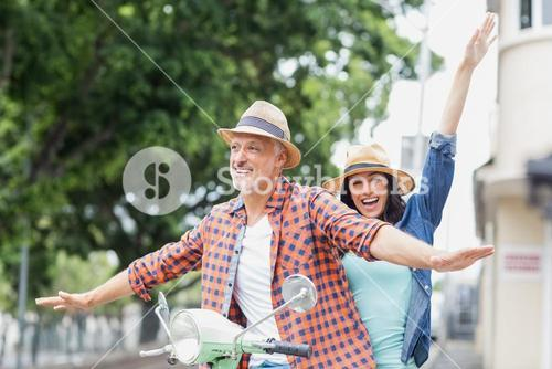 Happy couple with arms outstretched