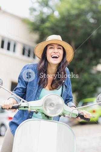 Excited woman enjoying moped