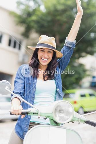 Portrait of woman riding with raised arm