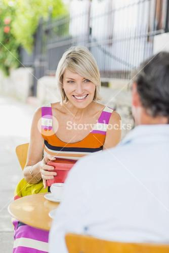 Woman with gift looking at man