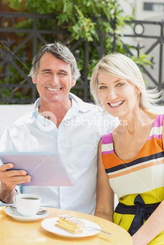 Portrait of happy couple with tablet