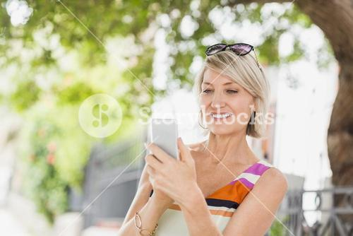 Happy woman using cellphone