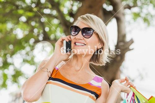 Happy woman listening to cellphone