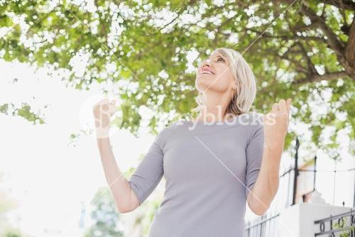 Happy woman with raised fists