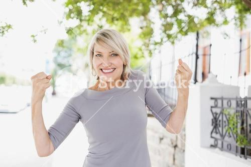Portrait of woman with raised fists