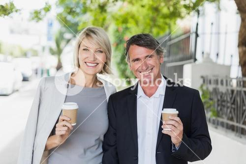 Portrait of happy business people with coffee