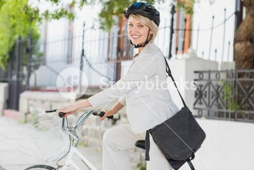 Portrait of businesswoman with helmet on cycle
