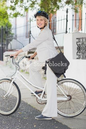 Portrait of businesswoman with bicycle