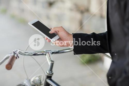 Midsection of businessman using cellphone