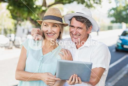 Man pointing to woman with digital tablet