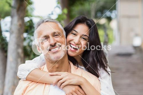 Woman embracing man from behind