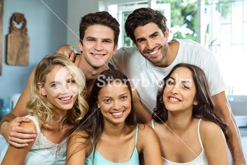 Happy young male and female friends at home