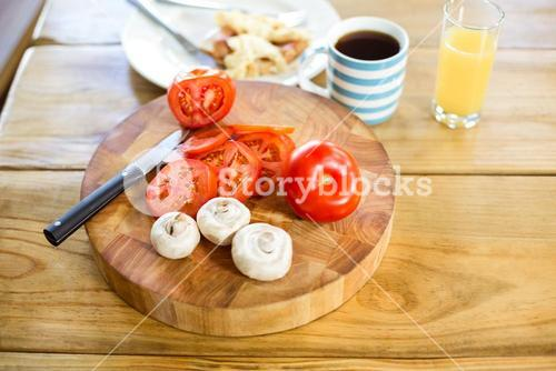 Vegetables with breakfast on table