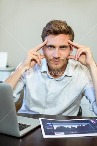 Portrait of frustrated businessman in office