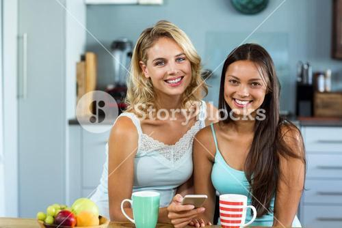 Portrait of happy female friends at home