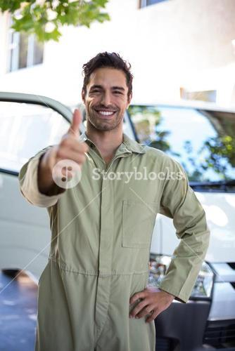 Portrait of smiling pesticide worker showing thumbs up