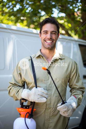Happy worker with pesticide sprayer
