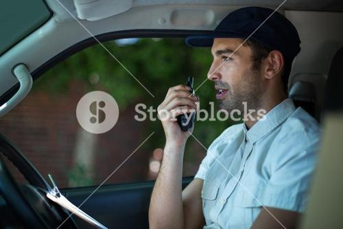 Delivery man using walkie-talkie