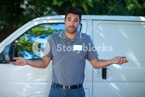 Portrait of delivery person gesturing