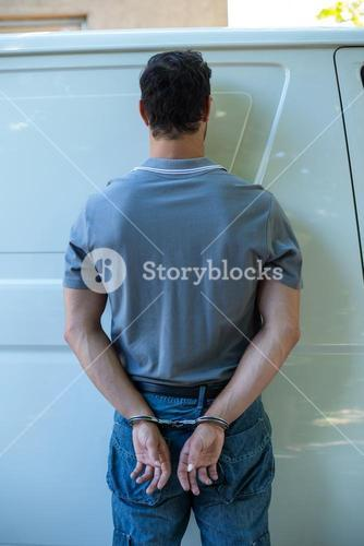 Rear view of man with handcuffs