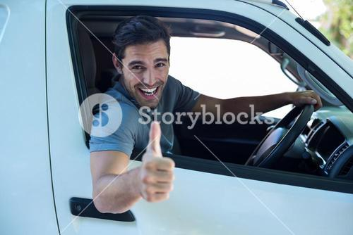 Portrait of cheerful man with thumbs up sign