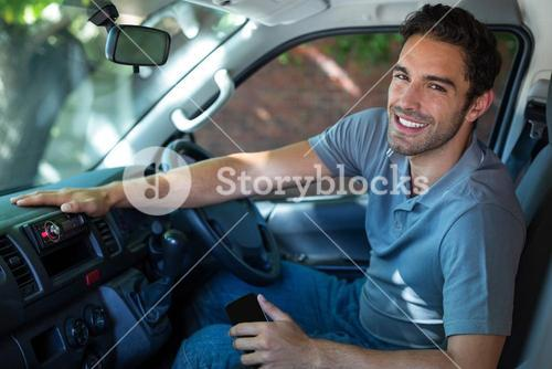 Smiling driver sitting in car